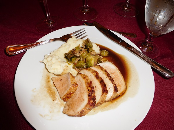 Pork tenderloin with smoked potatoes and caramelized brussel sprouts with bacon