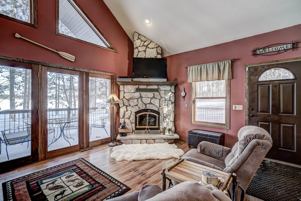 Century 21 cabin interior with stone fireplace