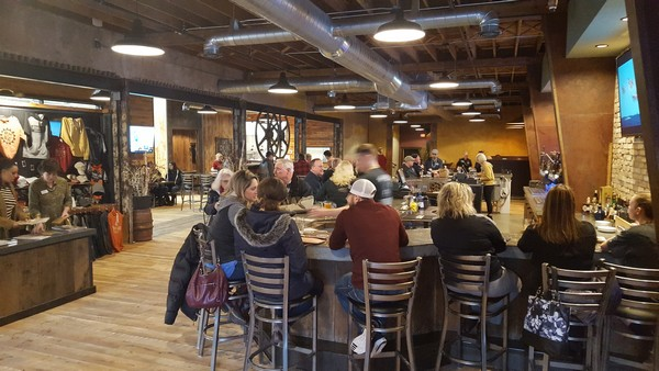 Round Man Brewing Co inside with long bar filled with people