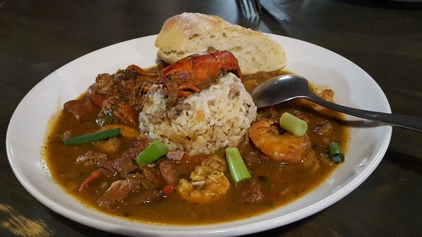 Shrimp Etouffee with rice and bread as a Marti Gras item