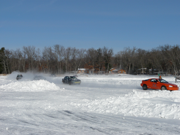 Cars speeding around track on frozen Clam Lake in Wisconsin
