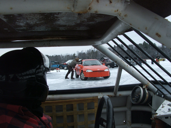 Race car driver looking at other cars on the frozen lake