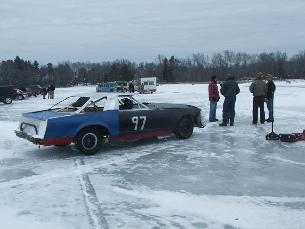 Spray painted and beat up car on the frozen lake