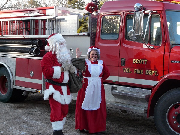 A stylish arrival for Santa and Mrs. Santa Claus