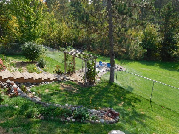 Attractive, low maintenance landscaping and a fire pit waiting for your coals.