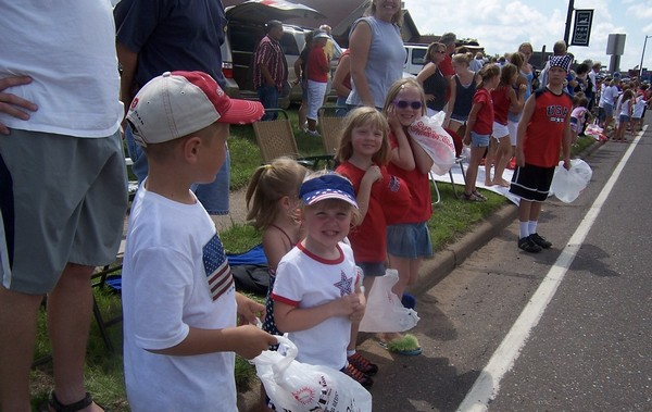 Children smiling during Fourth of July parade