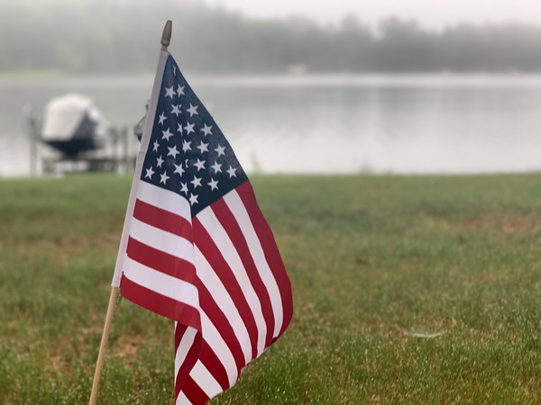 Close up of American flag near a Wisconsin lake