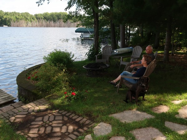 John and Evalee Miller sitting outside looking at the lake
