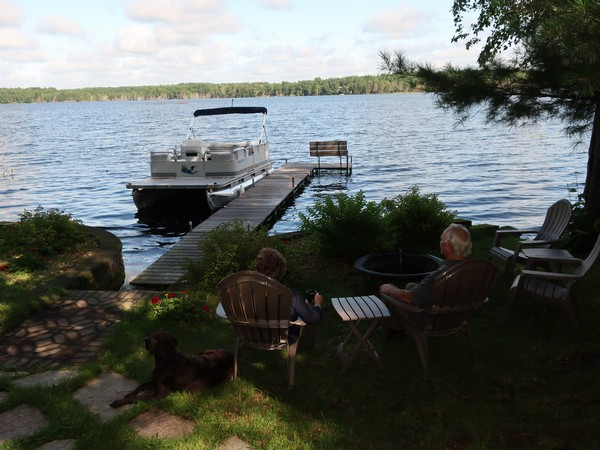 The Millers sitting by the lake admiring the view