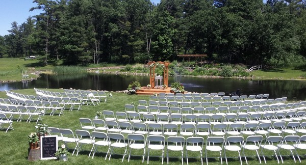 Coyland venue space with seating and arch by water