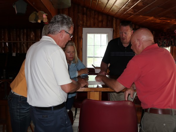 Century 21 Sand County agents discussing inside propery
