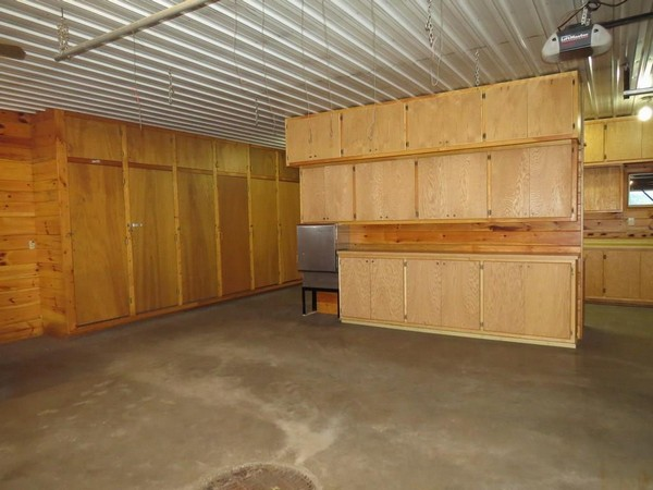 Interior of Webster, WI garage with wood shelves and walls