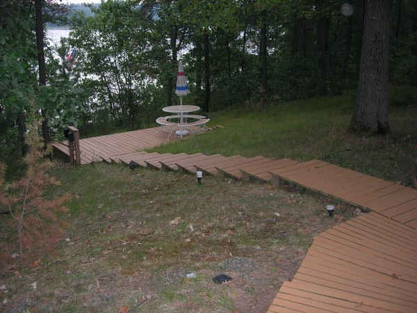 Steps from cabin down to landing area and lake