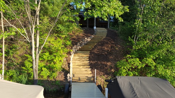 View from dock of curved steps up to cabin