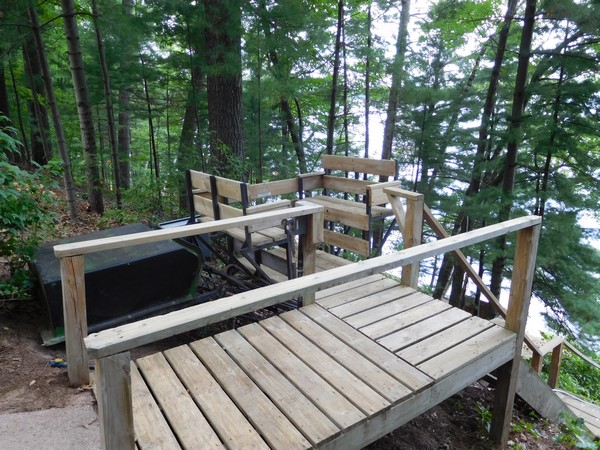Wood steps from lakefront cabin property down to water