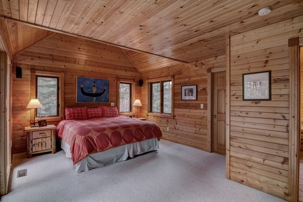 Main floor master suite with walk-in closet, jet tub and private master deck