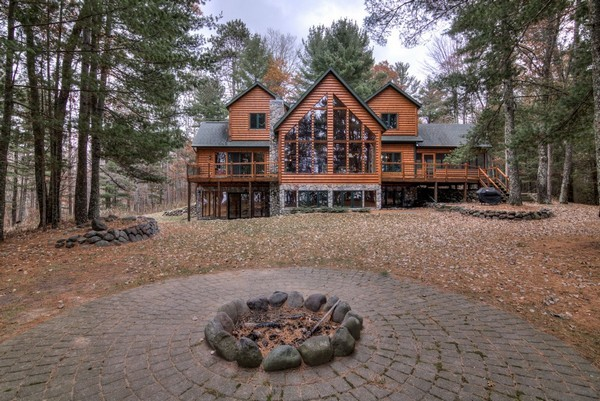 Paths to the lake and the swing radiate from the fire pit with paver stone