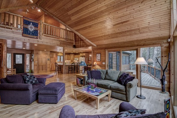 Wood floors, log accents, open loft and vaulted ceilings